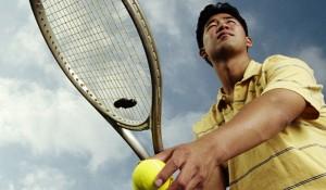 Man Serving Tennis Ball
