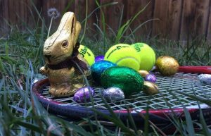 easter eggs and tennis racket