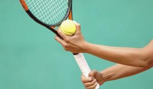 Tennis Player Preparing to Serve