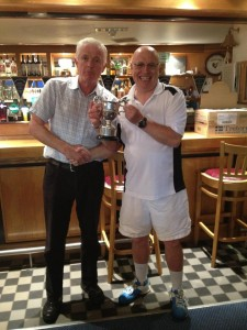 Michael Relihan Butler Cup Winner 2015 receiving the Cup from Captain Monday - Mark Robinson